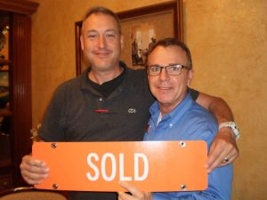 Bob Bensen and client with sold sign
